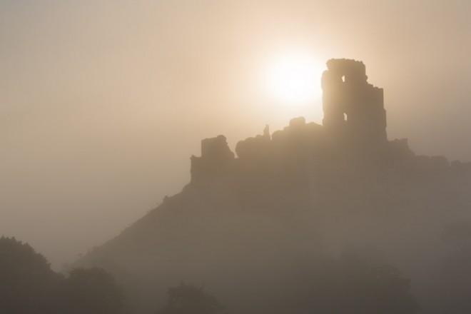 Corfe Castle, rising sun