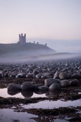 Dunstanburgh Castle, misty dawn